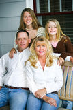 Portrait - Beautiful Family. Portrait of a beautiful family sitting on their front porch swing Stock Images