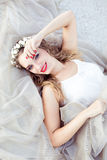 Portrait of a beautiful fashion bride, sweet and sensual. Wedding make up and hair. Flowers background. Art modern style. Blue eye Stock Image