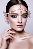Portrait of a beautiful fashion brunette bride, sweet and sensual. Wedding make up and hair. Blue eyes. Royalty Free Stock Images