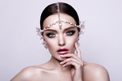 Portrait of a beautiful fashion brunette bride, sweet and sensual. Wedding make up and hair. Blue eyes. Stock Image