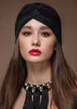Portrait Beautiful fashion east woman. Indian arabic girl with black turban. Stock Images