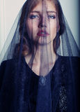Portrait of beautiful fashion model with black veil on face Stock Photos