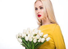 Portrait of  beautiful fashion model with bouquet  lily in hands, sweet and sensual. Beauty makeup, hair. Stock Images
