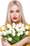 Portrait of  beautiful fashion model with bouquet  lily in hands, sweet and sensual. Beauty makeup, hair. Royalty Free Stock Images
