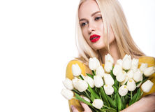 Portrait of  beautiful fashion model with bouquet  lily in hands, sweet and sensual. Beauty makeup, hair. Royalty Free Stock Photo
