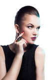 Portrait of beautiful fashion model posing in exclusive jewelry. Stock Photography