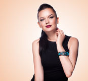 Portrait of beautiful fashion model posing in exclusive jewelry. Stock Images