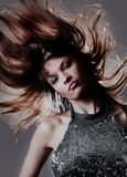 Portrait of beautiful and fashion model woman with blown hairs. Stock Image