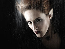 Portrait of a beautiful fashion vampire Royalty Free Stock Images