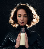 Portrait of beautiful fashion woman drinking milk from the bottl Royalty Free Stock Photo