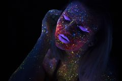 Portrait of Beautiful Fashion Woman in Neon UF Light. Model Girl with Fluorescent Creative Psychedelic MakeUp, Art Stock Photography