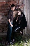 Portrait of beautiful fashion young woman and man. In outdoor setting Royalty Free Stock Images
