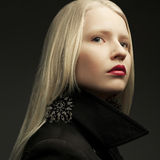 Portrait of beautiful fashionable model with natural blond hair. Portrait of a beautiful fashionable model with natural blond hair and great make-up posing over royalty free stock photos