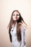 Portrait of beautiful female. Model on beige background Stock Image