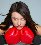 Portrait of beautiful female boxer Stock Photos