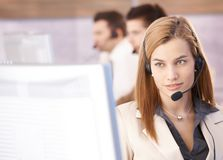 Portrait of beautiful female dispatcher. Working in call center Royalty Free Stock Image
