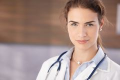 Portrait of beautiful female doctor in hospital Stock Photos