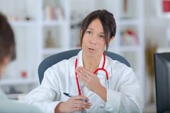 Portrait beautiful female doctor in office Royalty Free Stock Image