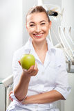 Portrait of beautiful female doctor in white uniform Stock Images