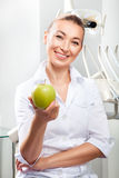 Portrait of beautiful female doctor in white uniform stock photography
