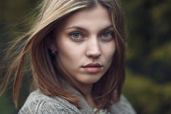Portrait of a beautiful female face close-up Stock Photos