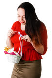 Portrait of beautiful female holding basket with E Stock Image
