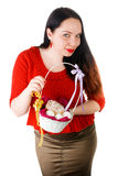 Portrait of beautiful female holding basket with Easter eggs isolated on white background Royalty Free Stock Photo