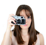 Portrait of beautiful female holding vintage camera with focus o Royalty Free Stock Photo