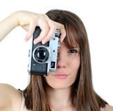 Portrait of beautiful female holding vintage camera Stock Photography