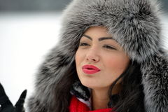 Portrait of beautiful female in luxurious fur head cloth Royalty Free Stock Photo