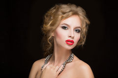 Portrait of beautiful female model on black Royalty Free Stock Photo