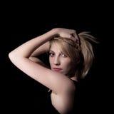 Portrait of a beautiful female model on dark background Stock Photo