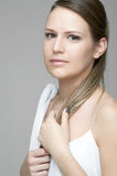 Portrait of beautiful female model on gray backgro. Und Stock Photo