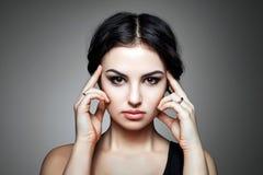 Portrait of beautiful female model on gray background Stock Photo