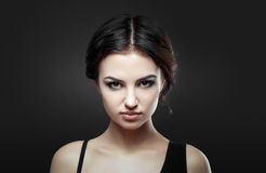 Portrait of beautiful female model on gray background Royalty Free Stock Photo