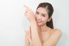 The Portrait of a beautiful female model Are smelling perfume on stock photos