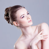 Portrait of a beautiful female model,  smiles  and Royalty Free Stock Images