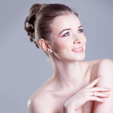 Portrait of a beautiful female model, smiles Royalty Free Stock Images