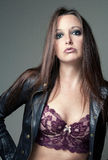 Portrait of beautiful female model wearing leather jacket and bustier Royalty Free Stock Photography