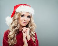 Portrait of beautiful female model wearing santa hat stock image