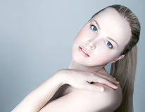 Portrait of a beautiful female model on white background Royalty Free Stock Images