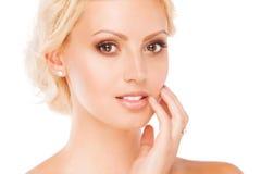 Portrait of beautiful female model on white. Background Royalty Free Stock Images