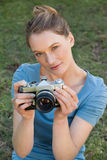 Portrait of a beautiful female photographer at park Stock Image