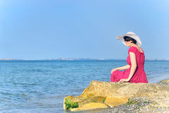 Portrait of beautiful female in red dress on beach Royalty Free Stock Photos