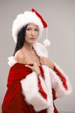 Portrait of beautiful female Santa posing Royalty Free Stock Photography