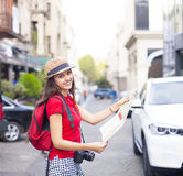 Portrait of a beautiful female tourist searching a place on the Royalty Free Stock Photos