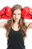 Portrait of a beautiful female wearing boxing gloves Royalty Free Stock Image