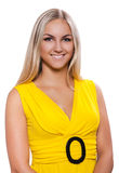 Portrait of a beautiful female in yellow dress Stock Images