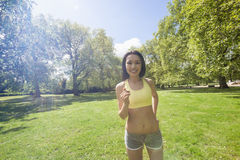 Portrait of beautiful fit asian woman jogging at park Royalty Free Stock Photography
