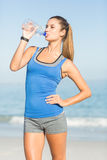 Portrait of beautiful fit woman drinking water Stock Photos